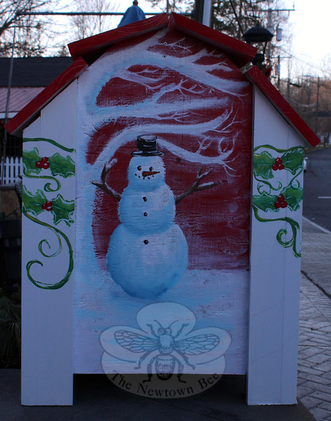 A snowman below a wintry tree decorates one of the four panels on the mailbox Newtown High School student Noël Carbone updated for SHOP this holiday season. (Hicks photo)