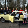 Newtown Lions Club members gathered at the home of member Paul Krueger on Sunday, December 13, to oversee the transition of the club's 2015 Mustang Raffle car, a 1966 Ford Mustang, to its new owner. This year's 2015 Mustang raffle came to a close on Saturday, October 17, at Edmond Town Hall when Reed Intermediate School student Justin Sims drew the winning raffle ticket. After Mr Krueger called winner Deb Grockowski of Bethlehem, he learned she had died in a car accident four days before the drawing. Ms Grockowski's brother Jeff Grockowski of Middletown picked up the 1966 Mustang Sunday for the family. He brought a framed photograph of his sister with him to pick up the car. Mr Grockowski said he and his two siblings shared a 1967 Mustang when they were young, with each sibling bringing the car with them to college. The 1966 raffled Mustang reminded Mr Grockowski of his family's old car. Mr Grockowski is pictured seated in the Mustang with a photo of his sister placed on the hood. Mustang raffle ticket drawer Justin Sims is pictured standing front right, and Newtown Lions Club members pictured from left are Skip Sims, Walk Schweikert, Ray Keegan, Frank Gardner, Bill Brett, Gary Fillion, Jim Guattery, Jon Christensen, Oscar De Los Santos, and Paul Krueger. (Hallabeck photo)