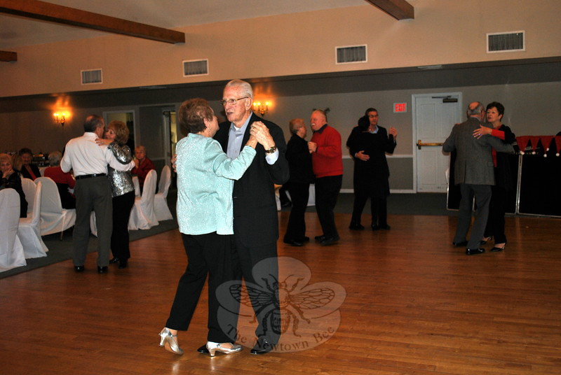 "Jean and Mike Cutro enjoy a slow dance to music selected by Sean ""Big Daddy,"" along with other guests at the Newtown Senior Center Holiday Party, Wednesday, December 9, at Michael's at the Grove. (Crevier photo)"