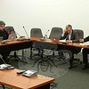 From left, newly elected Board of Finance members Mark Boland, Sandy Roussas, Kelley Johnson, John Godin, and James Gaston, Sr, listen as Aaron Carlson makes a point during discussion about electing a chair during the board's first meeting December 14. After discussion, several failed motions split on party lines, and a brief recess, the board's only incumbent Republican, John Godin, cross-endorsed Mr Gaston, a Democrat, for the chair. (Voket photo)