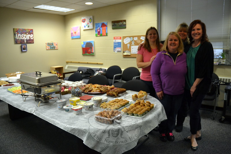 Standing in Middle Gate Elementary School's newly decorated teachers lounge on Monday, December 14, are PTA volunteers Jennifer Sinapi, Roxann Monaghan, PTA President Debbie DeBlasi, and Sheila Rice. The women helped organize a breakfast for school teachers early in the morning of 12/14. (Hallabeck photo)