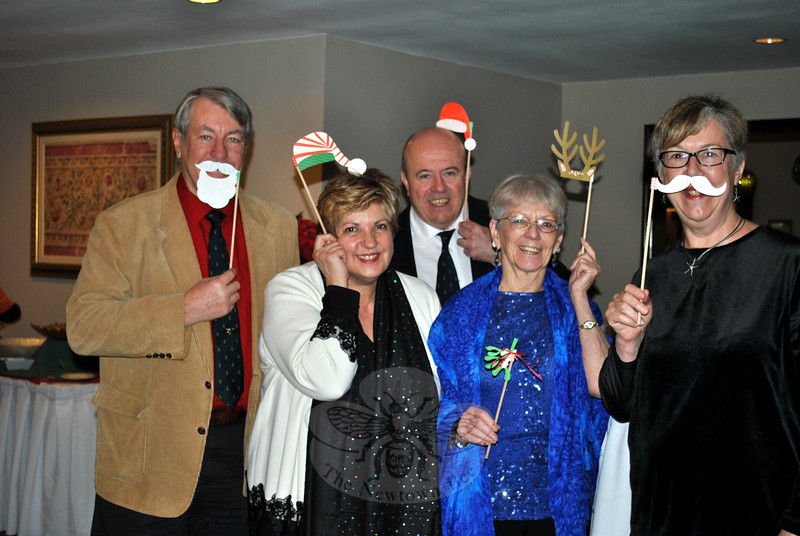 There is time for silliness at the elegant Newtown Senior Center Holiday Party. From left, Bob Place, Center Director Marilyn Place, Don Strait, Marlene Whitney, and Cindy Strait have a little fun. (Crevier photo)