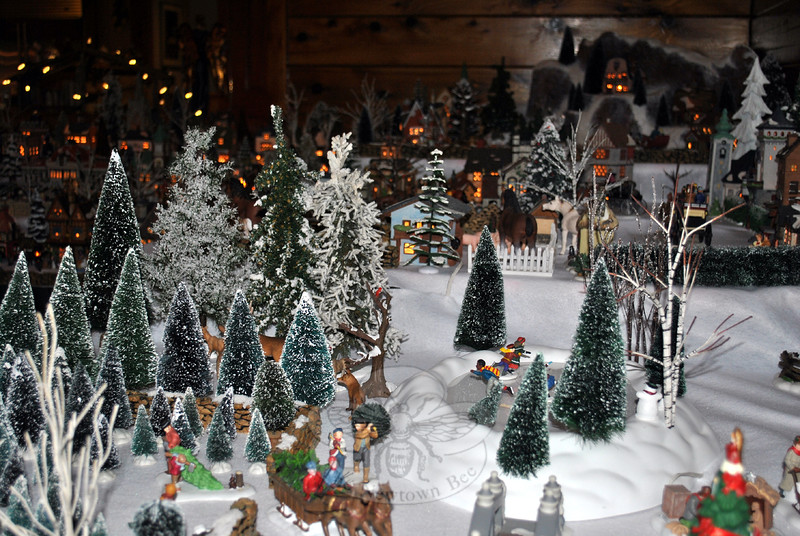Motorized skaters move about the ice skating pond, just one small section of the Department 56 Christmas Village constructed by Tom Catalina in his Butterfield Road home. The scenes include 63 buildings and hundreds of accessories spread over two large multilevel tabletops. (Crevier photo)
