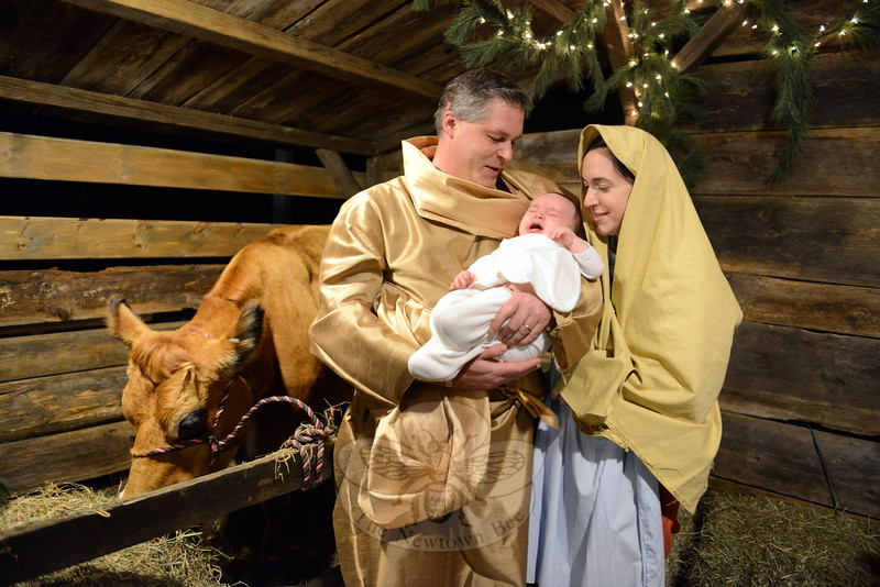Wynn Donnerstag fusses in his father Patrick Donnerstag's (Joseph) arms while  mother Alexis (Mary) helps calm him at St Rose of Lima's outdoors living nativity scene, December 12. (Bobowick photo)