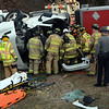 Sandy Hook and Newtown Hook & Ladder volunteer firefighters worked midday on Tuesday, December 15, to extricate the driver from the cab of a tractor-trailer truck involved in a one-vehicle rollover accident on the Exit 11 off-ramp of Interstate 84. Motorists were detoured from the accident scene. (Gorosko photo)