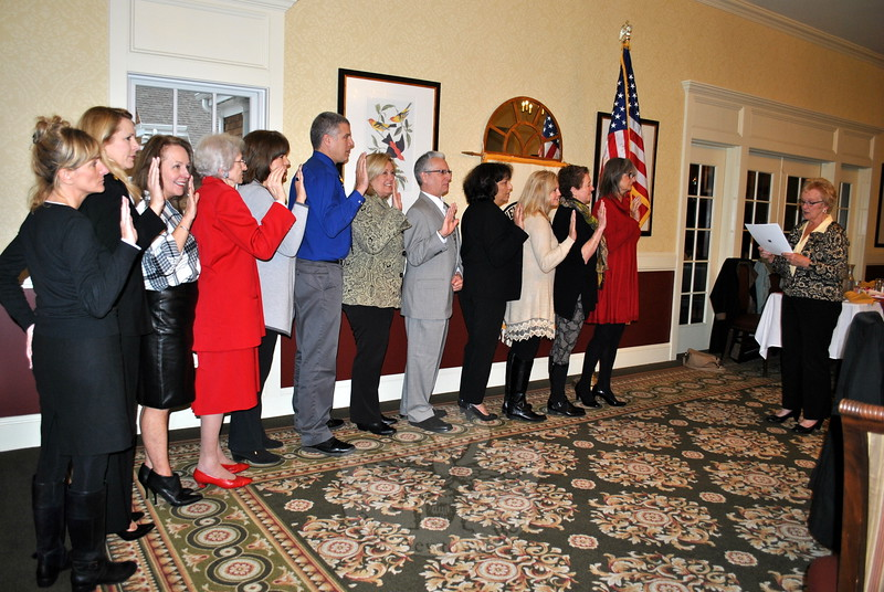 Newtown First Selectman Pat Llodra, far right, administers the oath of office to the 2016 slate of officers of the Newtown Board of Realtors, Thursday, November 19. From left are realtors Kathy Suhoza, Anne Stark, Kathy Berg, Alice Holmes, Jackie Himmelfarb, David Landau, Vincent Capuano, Michele Brown, Marcy Clair, Connie Widmann, and President Barbara Frey. (Crevier photo)