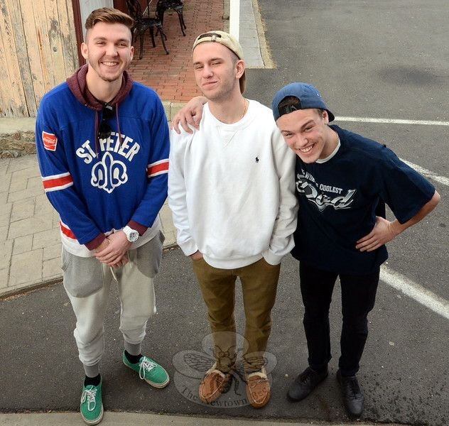Newtown High School seniors Zach Aumueller, left and Chris Daly flank recent NHS graduate and rapper Mason West a/k/a Stirling DuBois. The three aspiring musicians began collaborating among themselves, utilizing Aumueller's production talents and skill for creating underlying electronic beats and sound patterns that underpin Daly and West's infectious rhymes. (Voket photo)