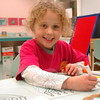 Lily Hunter was one of a number of children who colored menorah candles, created penguins, or decorated paper gingerbread people during the Drop-In Crafts event held at C.H. Booth Library on De-cember 6. Children between the ages of 3 and 7 were invited to participate in the 90-minute program. (Hallabeck photo)