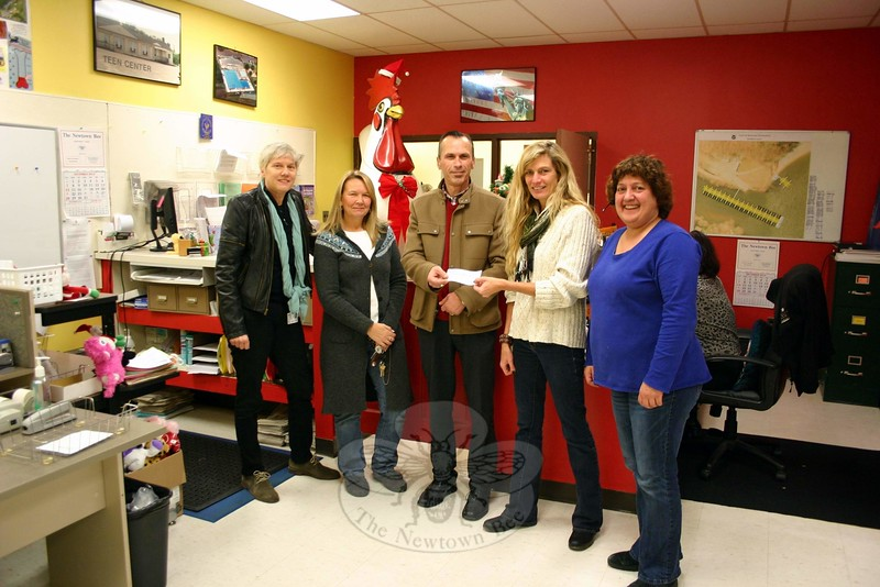 The Newtown Alumni Fund made a $1,000 donation to Newtown Parks & Rec's Campership Fund on December 5. From left are NAF members Cheryl Hensel, Kitt Colvin Hannah, and Arjan Zoto, Parks & Recreation Director Amy Mangold, and Assistant Director of Recreation RoseAnn Reggiano. (Hicks photo)