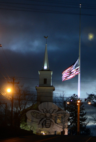Just after sunset on Sunday, December 14 — and minutes before Hook & Ladder volunteers raised the half-mast flag back to its full height — attendees began converging at the Newtown Meeting House for a planned Interfaith Service offering prayers and blessings on the second anniversary of the Sandy Hook tragedy. (Voket photo)