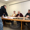 Police Commission members this week decided they want Newtown Hook & Ladder Company No 1, the volunteer fire unit that serves the borough and adjacent areas, to provide a formal study to them on the traffic impact of having a planned new firehouse at 12 Church Hill Road. The commission is the local traffic authority. Shown at a December 16 Police Commission session are: Rob Manna of Hook & Ladder, standing at left, and seated, from left, Police Commission member Joel Faxon, Chairman Paul Mangiafico, commission member Virgil Procaccini, Jr, and Police Chief Michael Kehoe. A site plan for the firehouse project lies on the table. (Gorosko photo)