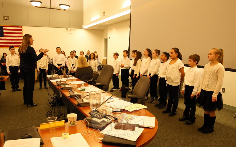 Head O' Meadow fourth grade chorus members sang for the Board of Education at its meeting on Tuesday, December 15. (Hallabeck photo)
