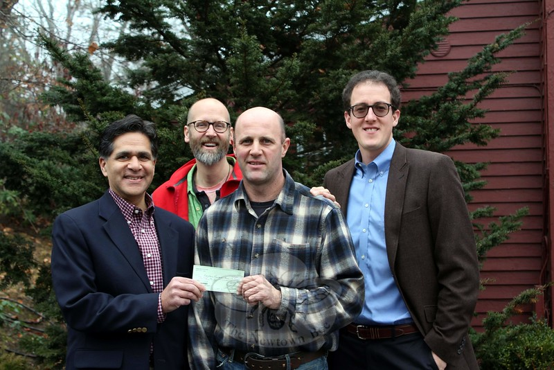 Members of the Newtown Earth Day Festival Committee met with Newtown Scholarship Association (NSA) President Glenn Nanavaty to present a donation to NSA. The festival committee has made an annual donation to NSA since 2012. That first donation resulted in a $3,000 award to a 2013 high school graduate planning to pursue a degree related to forestry/environmental sciences. Since that time, between donations from the festival committee and supplemental funds from NSA, three additional scholarships have been awarded on behalf of the two groups, totaling $15,000. On December 14 Mr Nanavaty, on the left, accepted this year's donation from Earth Day Festival Committee members, continuing to the right, Bill Buchler, Dan Holmes, and Dr Aaron Coopersmith. NSA was formed in 1937 to provide need-based financial aid to Newtown residents attending college. (Hicks photo)