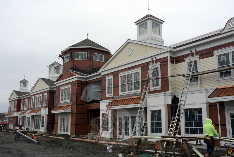 On Friday, December 18, workers continued constructing the façade on the southernmost building at The Village at Lexington Gardens, a commercial complex being built at 32 Church Hill Road. The facility is the largest commercial development in the borough in many years. (Gorosko photo)