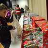 Head O' Meadow student Rafael Frable searched for gifts to give his family members for the holidays on Thursday, December 10, at the school's Holiday Giving Shop. (Hallabeck photo)