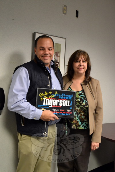 Todd Ingersoll, president of Ingersoll Automotive, delivered ten laptops to Newtown High School Principal Lorrie Rodrigue on Wednesday, December 9. This is the fourth year the company has donated laptops to local schools for use by students who do not have access to technology at home. (Hallabeck photo)