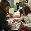 Christine Ford, left, and daughter Maddie wrapped a present at Middle Gate Elementary School's shopping boutique on Friday, December 11. (Hallabeck photo)