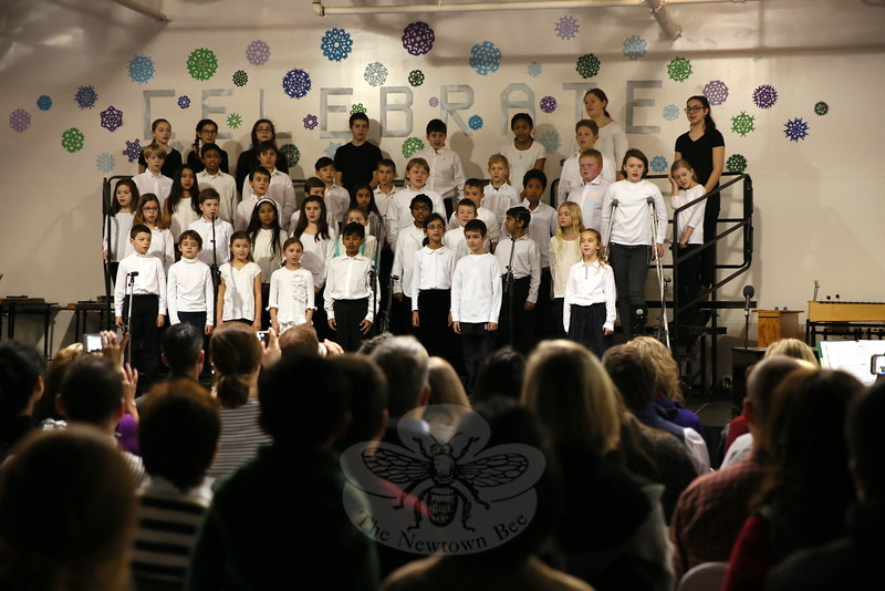 Fraser Woods Montessori School students sang for family and friends during the school's annual Holiday Celebration on Thursday, December 17. (Hallabeck photo)