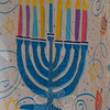 A table covering is decorated with a menorah, the nine-branched candelabrum that symbolizes Ha-nukkah. (Gorosko photo)