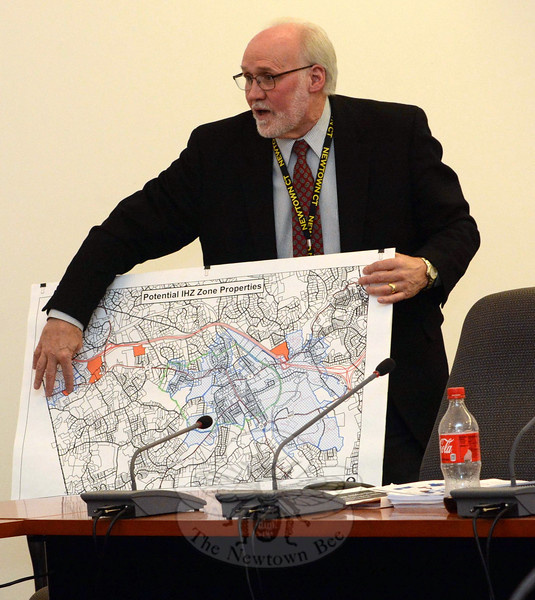 George Benson, town director of planning, shows Planning and Zoning Commission members a map depicting the seven local land parcels that potentially could be sites for multifamily housing with an affordable housing component, under the terms of a proposed new land use zone known as Mixed-Use, Mixed-Income Overlay Zone (MUMI-10). (Gorosko photo)