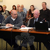 On December 18, the Planning and Zoning Commission received testimony at a public hearing on The Preserve at Newtown, a proposed 23-lot residential subdivision in Dodgingtown. Seated at the testimony table are the applicants' representatives. Shown, from left, are engineer Daniel Kroeber, builder/developer George L. Trudell II, attorney Francis Collins, and hydrogeologist David Murphy. (Gorosko photo)
