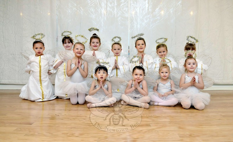 Nutcracker Suite by Newtown Centre of Classical Ballet has a number of 3- to 6-year-olds cast as angels for Sunday's performances. Top row from left are Morgan Ferris, Gwenyth Tait, Mary Morrison, Micah Loutensock, Vivien Vass, Fiona Shaw, and Caitlin Potter. In front, also from left, is Zoe Giordano, Sabrina Lee, Maggie Grasso, Rory Eberlin, and Dezelene Fernandez. (Bobowick photo)
