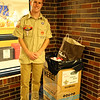 Newtown High School senior and Boy Scout Ethan Burg stood with a box for his collection for Soles4Souls at the high school on Monday, November 23. (Hallabeck photo)