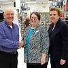 Newtown Chamber of Commerce members Peggy Velthuizen, center, and Carole Georges stopped in to Newtown Hardware on November 19 to offer their thanks on behalf of the chamber to Mike Sorrentino, owner of the store. Mr Sorrentino has for years donated many of the candles that are used in the luminarias that lead residents to Ram Pasture for the annual tree lighting ceremony. Ms Velthuizen works at Union Savings Bank, which will be donating cookies for this year's tree lighting; Ms Georges is an employee of People's United, which is donating apple cider for December 4. (Hicks photo)