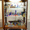 C.H. Booth Library is hosting its annual display from Hadassah of Newtown/Greater Danbury of Hanukkah menorahs, or chanukiah, according to a notice within this year's display. Nineteen examples of the nine-branched candelabrum are on view, and they range in size and style, from a tiny silver traditional example to larger models made of fused glass or glazed clay. The menorahs are on loan from various members of the local Hadassah organization, according to Debra Pollack Wollman, who set up the temporary exhibition on December 1. The collection will remain on view until December 14. While menorahs should be placed in the window of a home so that passersby can enjoy its beauty and appreciate the warmth of the Festival of Lights, this collection can be found in a display case on the library's main floor, near the Fiction and Young Adult areas. (Hicks photo)
