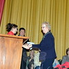 Town Clerk Debbie Aurelia Halstead, left, shook hands with First Selectman Pat Llodra after she was sworn in to her fourth term on Sunday afternoon. State Senator Tony Hwang, background, shared the stage with dozens of men and women preparing to begin their terms to various boards and commissions on December 1. (Bobowick photo)