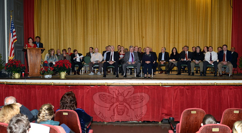 Town Clerk Debbie Aurelia Halstead, at the podium, with State Senator Tony Hwang at her side, gave the oath of office to nearly three dozen residents on Sunday afternoon at Edmond Town Hall. The elected officials were returning or taking new positions on a number of town boards and commissions, all effective December 1. (Bobowick photo)