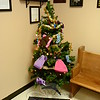 "The police department is sponsoring its 14th Annual Mitten Tree display in the police station lobby at 3 Main Street until January 1. Police Patrol Officer Maryhelen McCarthy, who oversees The Mitten Tree Project, asks that residents make donations of new mittens, hats, and scarves to adorn the Christmas tree. Through the course of the holiday season, the tree will occasionally be ""trimmed,"" with the donated apparel being given to needy families. The police station is open around the clock, seven days a week. (Gorosko photo)"