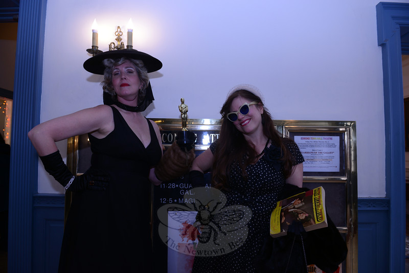 """Film buffs were invited to """"dress the part"""" for the red carpet at the special screening of Gone With The Wind on November 30 at Edmond Town Hall. Andrea Andrew brought her own award and an adoring fan, Nicole Christensen, right, dressed in appropriate period attire. (Bobowick photo)"""