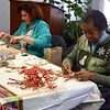 Members of The Garden Club of Newtown always come up with different ways to enhance the wreaths and swags that have traditionally been used as holiday home décor. Betsy Godin, on the left, and Vernice Murphy were among club members creating cinnamon bundles and pipe cleaner candy canes for just that purpose. (Hicks photo)