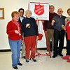 Volunteers with the Newtown/Bethel Chapter of Salvation Army kick off the 2014 Kettle Campaign. Ringers will be posted outside of local businesses Fridays and Saturdays, December 12–13 and 19–20, seeking donations to benefit local residents in need. From left are Marie Sturdevant, Glenn Nanavaty, Peg Forbell, Steve Bennett, Alan Martin, and Anna Wiedemann. (Crevier photo)