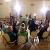 Sandy Hook School staffer Mary Ann Jacob stands among a large group of colleagues who gathered November 13 in the Alexandria Room at Edmond Town Hall, where they discussed a number of gun violence prevention issues. That meeting was filmed for segments of a CBS Sunday Morning report with Jane Pauley set to air December 7. (Voket photo)