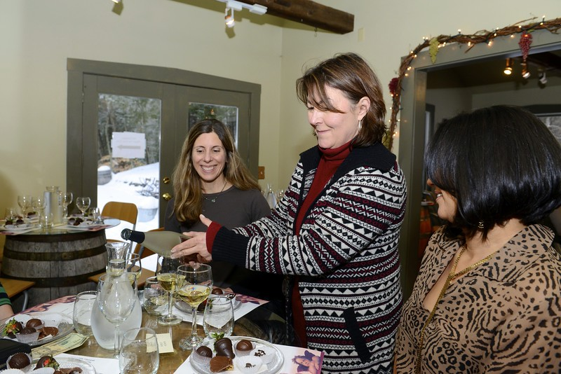 McLaughlin Vineyard General Manager Dee Dee Lynn pours a taste of white for friends Alison Washington, left, and Kerly Fattibene. (Bobowick photo)