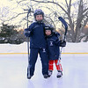 Earlier this month on a cold afternoon, Emma and Owen Hannah practiced their hockey maneuvers and skating skills at their home ice rink on Wendover Road. Their father Shaun Hannah built the skat-ing space a few years ago. (Bobowick photo)