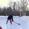 Earlier this month on a cold afternoon, Emma and Owen Hannah practiced their hockey maneuvers and skating skills at their home ice rink on Wendover Road. Their father Shaun Hannah built the skat-ing space a few years ago.Owen, 4, plays at Yale's learn to play hockey program, which Mr Hannah also coached. (Bobowick photo)