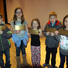Golden ticket winners from Middle Gate Elementary School's Family Movie Night at Edmond Town Hall on Friday, February 6, from left, were Grant Crossman, Emily Joyce, Lauren Thebodo, Patrick Ward, and Ashley Schrader. Lauren was the grand winner during the event. (Hallabeck photo)