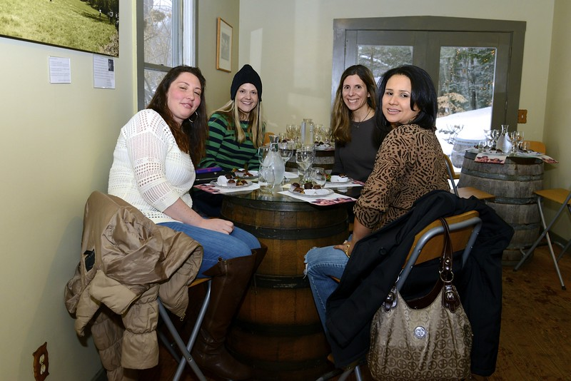 Friends attending Sunday's wine tasting at the vineyard in Sandy Hook would soon share a toast to the wintry afternoon. From left are Meg Vertillo of Danbury, Sandy Hook resident Melissa Fattibene, Alison Washington of  Southbury, and Kerly Fattibene of Brookfield. (Bobowick photo)