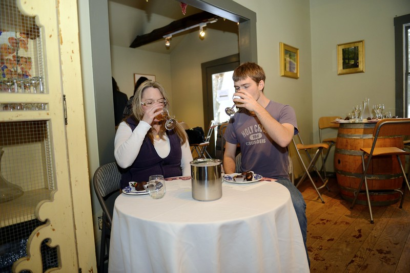 Bethel residents Margaret Lord and her son Colin Cote sample a white wine, while waiting on their plates is a selection of chocolate-covered desserts. (Bobowick photo)