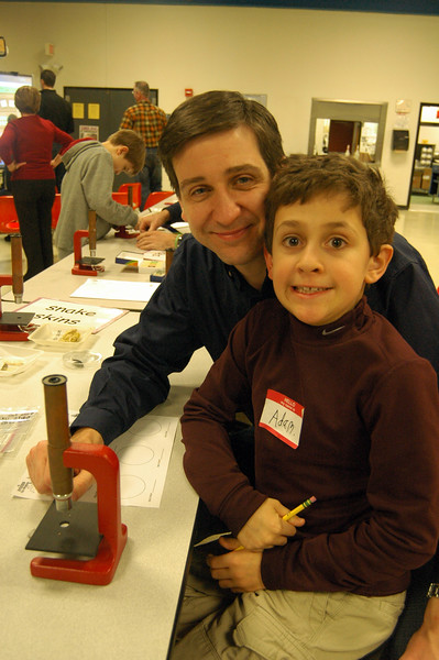 Head O' Meadow student Adam Mavriello and his father Brian worked at one station during Head O' Meadow's STEM event on Thursday, February 5. (Hallabeck photo)