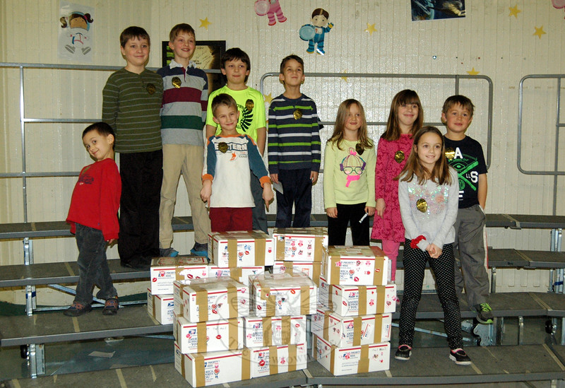 Sandy Hook School students worked to prepare boxes of letters and other items to be sent to troops serving overseas through the Valentines For Troops effort on Tuesday, February 10. Students in the back row from left are Mathew Holden, Kyle Tabor, Henry Terifay, Brian Sibley, Nicole Tabor, Ally Holden, and Collin Whitmore. Standing in the front from left are Aaron Fung, Stephen Sibley, and Sarah Jojo. (Hallabeck photo)
