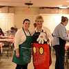 Kym Venezia and Minnie Mouse, aka Melanie Mattegat, pause during their work serving dinners and coffee Tuesday night at the St John's Episcopal Church Hall for the annual Shrove Tuesday Pancake Supper. Around them are tables beginning to fill shortly after 5 pm. (Bobowick photo)