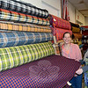 Chintz-N-Prints owner Laura Gardner, left, and her manager Ivy Chirco show a sample of vintage fabric from among thousands of bolts and rolls housed in the South Main Street store. The store has, in recent years, been a popular destination for film and television designers who have used Chintz-N-Prints fabrics to help dress sets for movies, including Bill Murray's latest release, St Vincent, Golden Globe winner American Hustle, and Silver Linings Playbook, featuring Academy Award winner Jennifer Lawrence. (Voket photo)