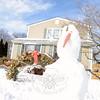 Twigs and a carrot give character to the otherwise lumpy snow face, and animation to a snowball body sitting on the front lawn at 15 Church Hill Road. With a grumpy appearance in its narrow, down-turned nose, this snowman is one of several that stood tall despite 40-degree temperatures Sunday afternoon, February 22. By that evening, the day's warmth pulled the snowmen down. (Bobowick photo)