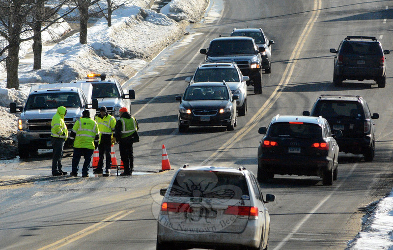 A group of Aquarion Water Company workers responded to a water line break, which was reported to police at about 7 am on Wednesday, February 25, on Church Hill Road, just east of its intersection with Wendover Road. The situation resulted in traffic detours while excavation and repairs were underway. (Gorosko photo)