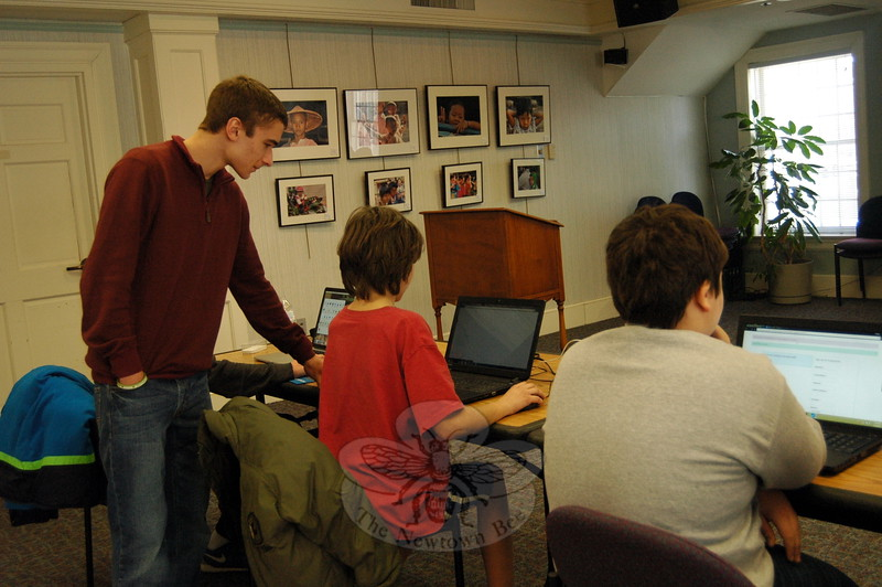 Newtown High School junior Brendan Gregory oversaw students taking his Computer Coding with Java course at C.H. Booth Library on Tuesday, February 3. (Hallabeck photo)