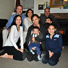 "The newly blended Gift of Life ""family,"" the Rosenthals and Alquilos, gather for a photo. From left, back row, Rotarian Dan Rosenthal, Meri Jitsukawa, and Rotarian Pat Caruso; front, Hana Rosenthal, Hazel Ricardel-Alquilos holding Bezalel, Ben Rosenthal (with family dog, Simon), and Emi Rosenthal. (Crevier photo)"